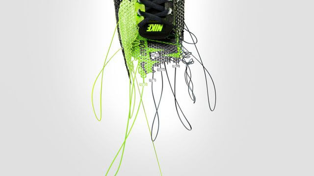 Computer generated image of a green and black sports shoe being untangled from a cotton reel