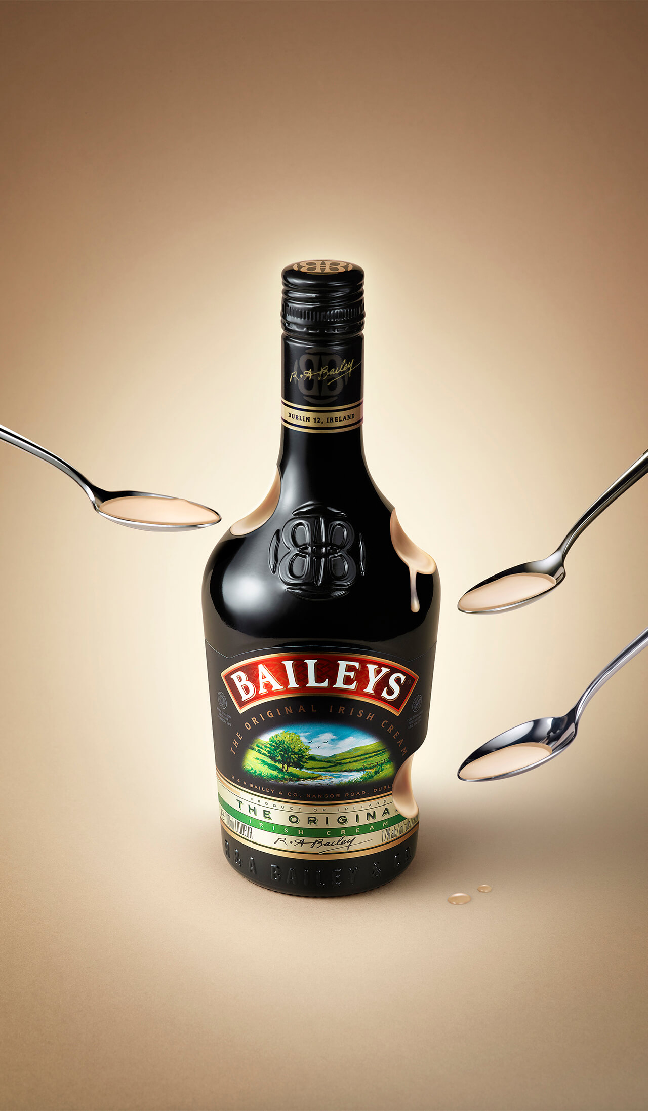 A Computer Generated Image of a Bottle Of Baileys Liquor with spoons scooping drink from the bottle