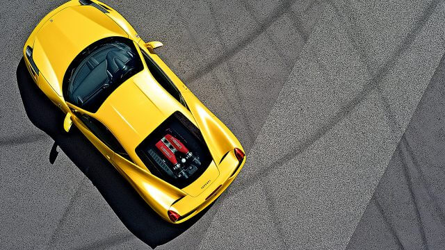 Birds Eye view of yellow Ferrari Racing Car with exposed engine