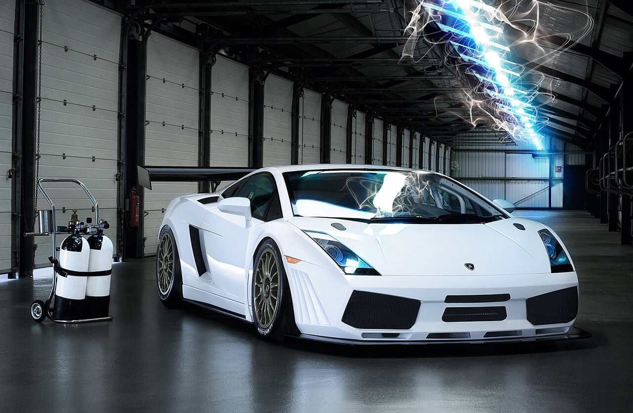 Image of white Lamborghini car in commercial garage with neon lighting