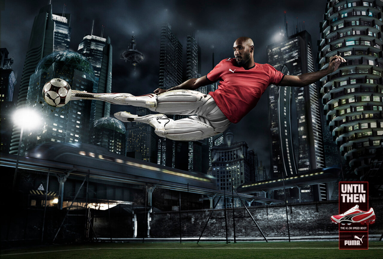 Computer Generated image of a part robot Soccer player scissor kicking a football on a soccer pitch in a futuristic city