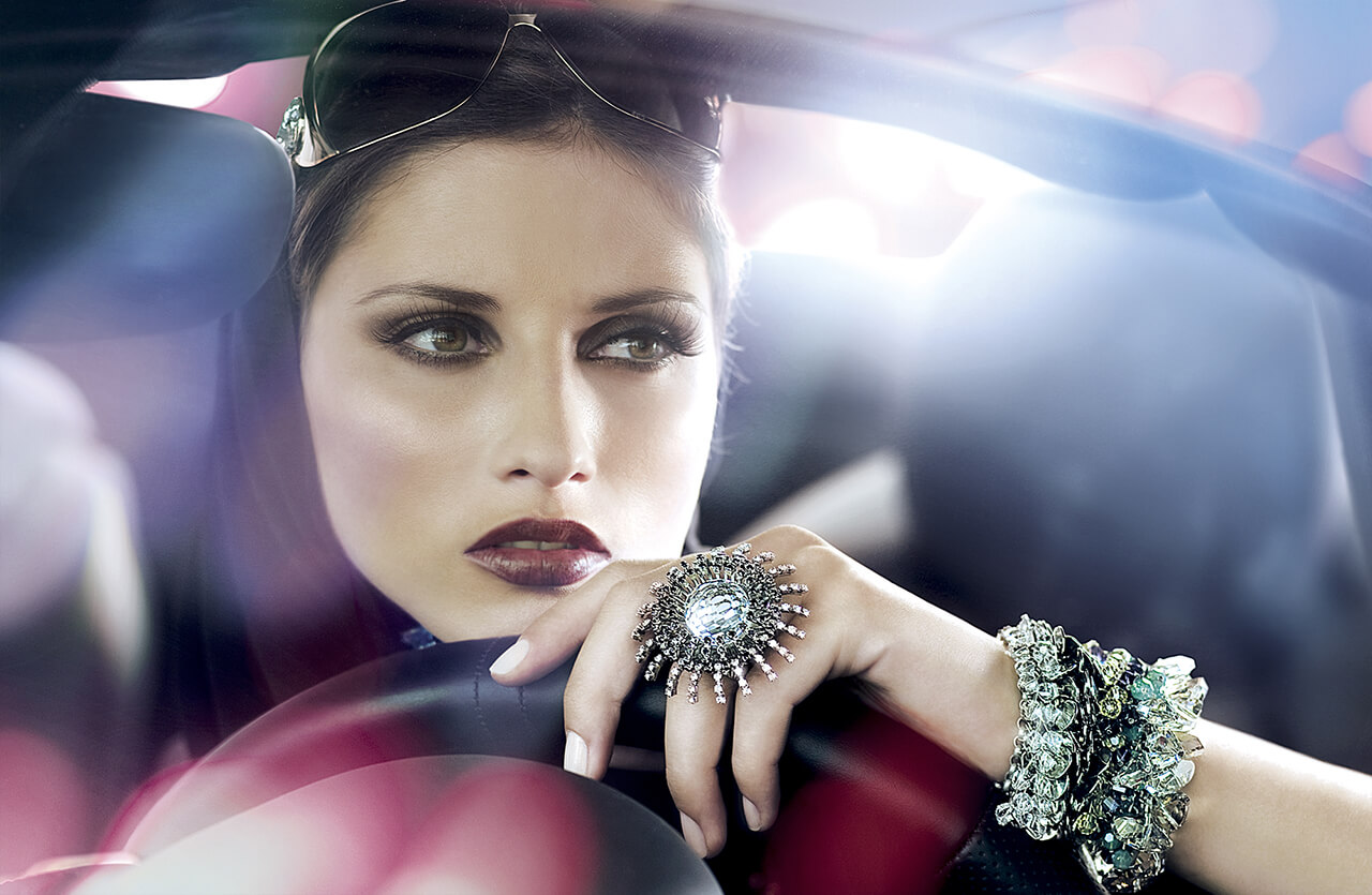 Retouched Image of beautiful lady driving car