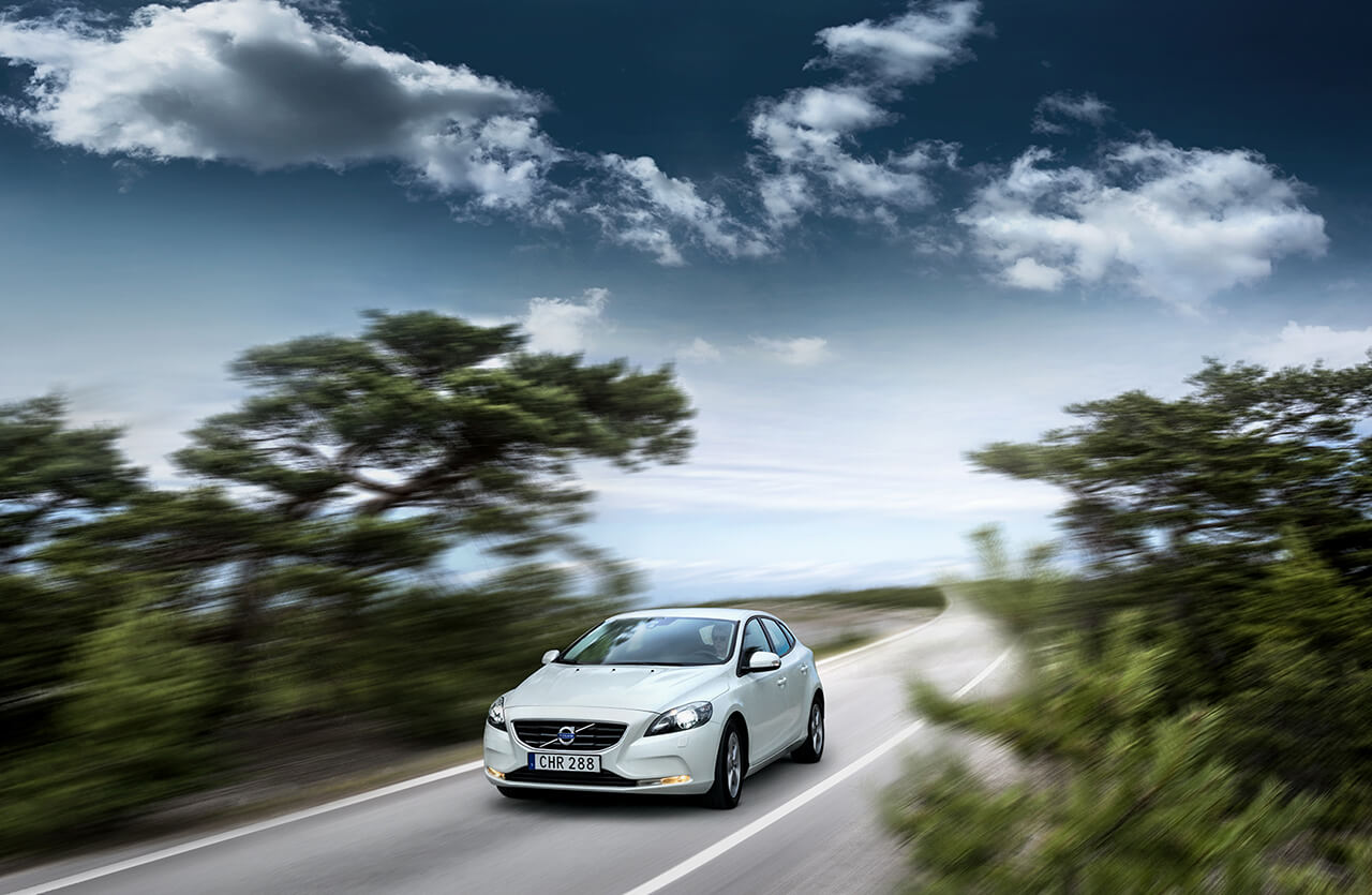 Computer Generated Image of Volvo driving along road with blurred foliage