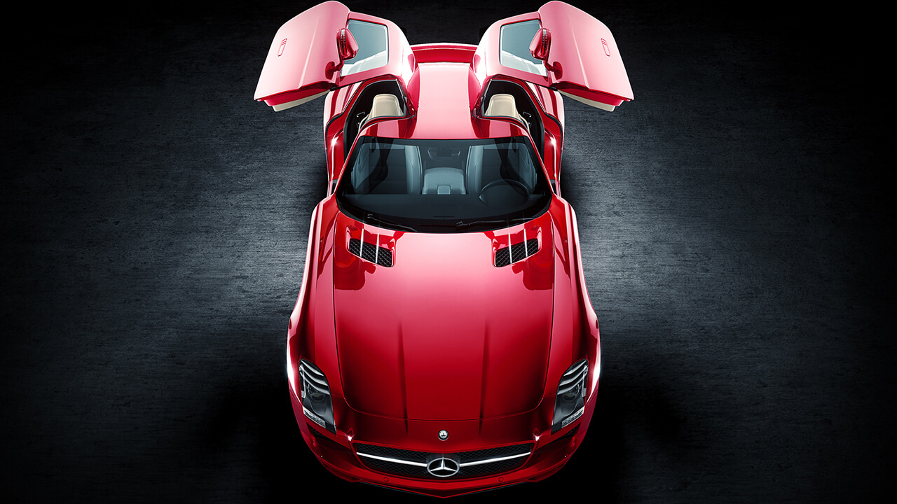Computer generated render of a red Mercedes with both doors lifted open