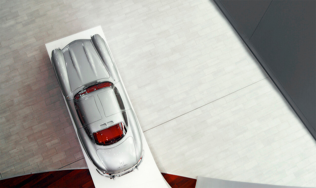 Aerial View Of A Silver Mercedes Car on a platform