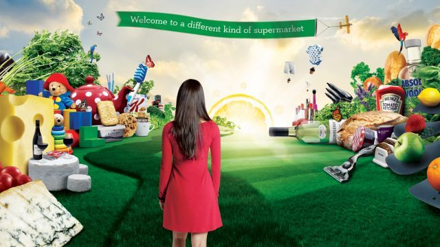 computer generated image showing the rear of a young lady in a red dress looking at a grass pathway with a lemon sun on the horizon and lots of food and shopping products piled up on either side